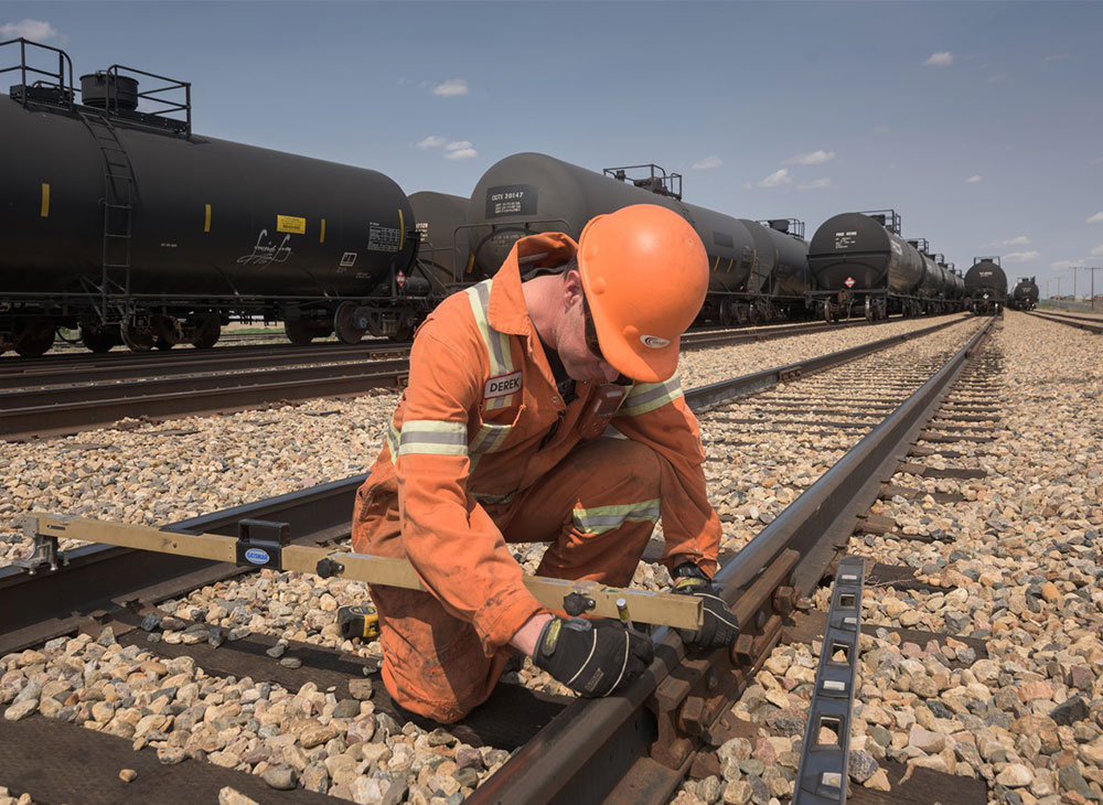Track inspector completing work order on track inspection software